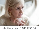 sad frustrated mature old woman ... | Shutterstock . vector #1185179104