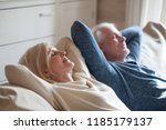calm senior mature couple... | Shutterstock . vector #1185179137