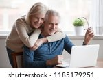 senior middle aged happy couple ... | Shutterstock . vector #1185179251