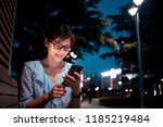 young woman using smartphone in ... | Shutterstock . vector #1185219484