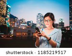 young woman using smartphone in ... | Shutterstock . vector #1185219517