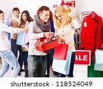 Shopping group people at sales in clothing store. - stock photo