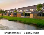 Row of residential houses with barn seen from the rear - stock photo