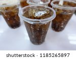 brown sparkling water and ice... | Shutterstock . vector #1185265897