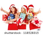 Women in Santa hat holding stack Christmas gift box. - stock photo