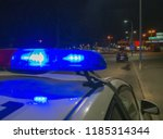 Police car lights in night time, crime scene. Night patrolling the city. Abstract blurry image.