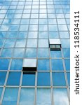 Windows on the office buildings with clouds reflecting - stock photo