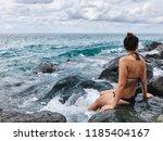 a girl on a stony beach  | Shutterstock . vector #1185404167