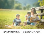 young pretty mother having... | Shutterstock . vector #1185407704