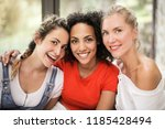 female young friends hanging... | Shutterstock . vector #1185428494