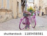 bicycle propped against a pole... | Shutterstock . vector #1185458581
