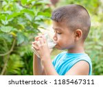 little asian boy drinking milk  ... | Shutterstock . vector #1185467311
