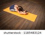 young  woman in bodysuit... | Shutterstock . vector #1185483124