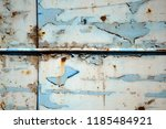 a rusty wall. blue and white... | Shutterstock . vector #1185484921