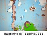 a rusty wall with a green... | Shutterstock . vector #1185487111