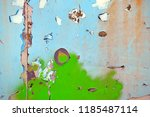 a rusty wall with a green... | Shutterstock . vector #1185487114