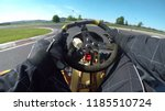 pov  driving a fast go kart in... | Shutterstock . vector #1185510724