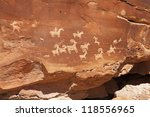 Native American petroglyphs on red sandstone cliffs in Arches National Park near Moab, Utah - stock photo