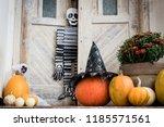 halloween decorated front door... | Shutterstock . vector #1185571561