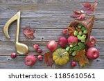 cornucopia with autumn harvest... | Shutterstock . vector #1185610561