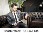 businessman using tablet at the ... | Shutterstock . vector #118561135