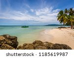 Stock photo amazing tropical beach in caribe boat with tourists palm trees white sand beach trinidad and 1185619987