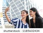 happy asian girls selfie with... | Shutterstock . vector #1185632434