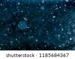 snowflakes against black... | Shutterstock . vector #1185684367