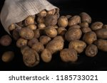 sack of fresh raw potatoes on... | Shutterstock . vector #1185733021