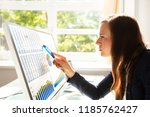 young businesswoman analyzing... | Shutterstock . vector #1185762427