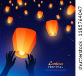 hands releasing lanterns into... | Shutterstock .eps vector #1185764047