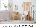 toilet bowl in modern bathroom... | Shutterstock . vector #1185789541