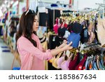 young woman choosing and buying ...   Shutterstock . vector #1185867634