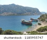 aegean island and ships    Shutterstock . vector #1185955747