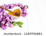 honey with acacia blossoms on a ... | Shutterstock . vector #1185956881