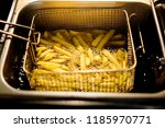 close up french fries potatoes... | Shutterstock . vector #1185970771