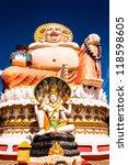 Smiling Buddha of wealth statue in Koh Samui, Thailand - stock photo