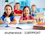 portrait of two diligent girls... | Shutterstock . vector #118599247