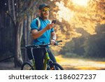 happy bearded man cyclist rides ... | Shutterstock . vector #1186027237