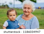 granddaughter and grandmother... | Shutterstock . vector #1186034947