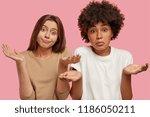 hesitant puzzled mixed race...   Shutterstock . vector #1186050211