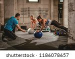 two girls exercising with a... | Shutterstock . vector #1186078657