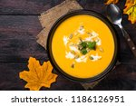 pumpkin cream soup with seeds... | Shutterstock . vector #1186126951