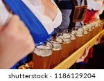 people in bavarian clothes with ... | Shutterstock . vector #1186129204