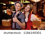 a young guy and a girl in... | Shutterstock . vector #1186140301