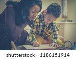 a helping hand. african...   Shutterstock . vector #1186151914