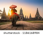 tourists with an elephant at... | Shutterstock . vector #1186168984