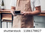 asian male barista wear apron... | Shutterstock . vector #1186178827