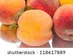 Tasty juicy peaches close up. Isolated on white background - stock photo