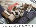 happy family in living room.... | Shutterstock . vector #1186202611